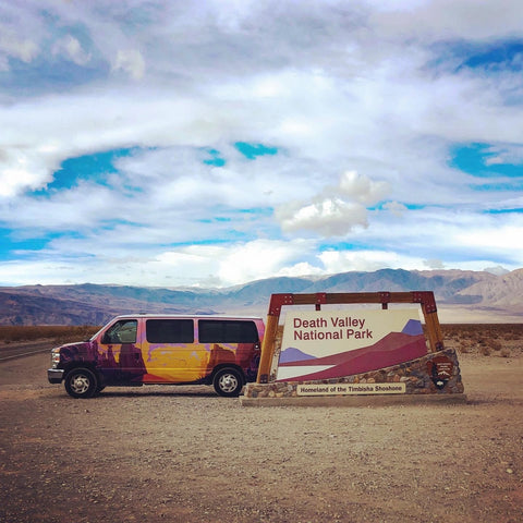 Escape Campervan in front of Death Valley NP sign
