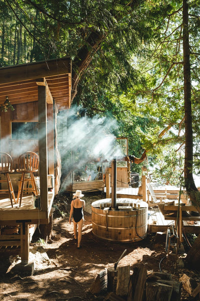 A dreamy boho-inspired off-grid cabin with an AlumiTubs wood-fired hot tub.