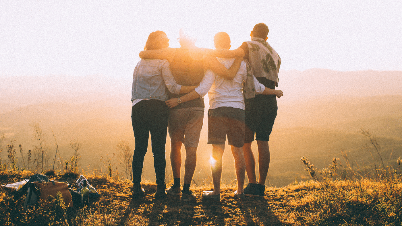 group hug team building photo sunset on a grassy hill overlooking mountains warrior medicine personal values workshop