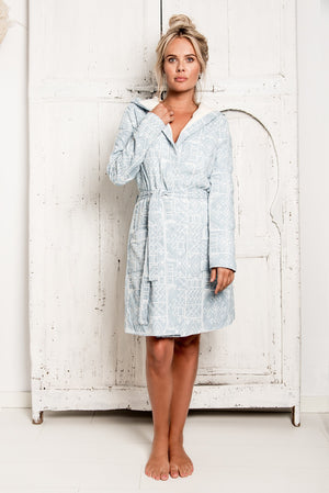 A bathrobe of True Bandits, hygge robe, with fully embroidered fabric, luxury look. Unique and special, light blue, soft towelling lining