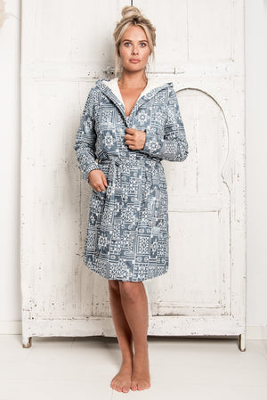 A new hygge robe, bathrobe, in dark blue fabric, allover embroidery and very soft inside because of the towelling lining. It has a tie-dye effect, every piece is unique.