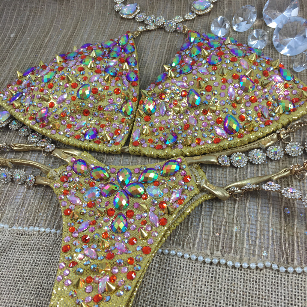 Custom Triangle Style Deluxe Golden studded Bling Themewear with wings $999 or bikini only $749 (This exact swatch may sell out and substitue used)