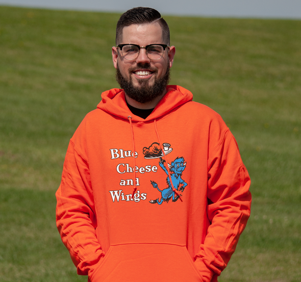 Sweatshirt Hoody, Orange (50% cotton, 50% polyester) Modeled by Matt Kaczor, son of former beneficiary Danny Kaczor