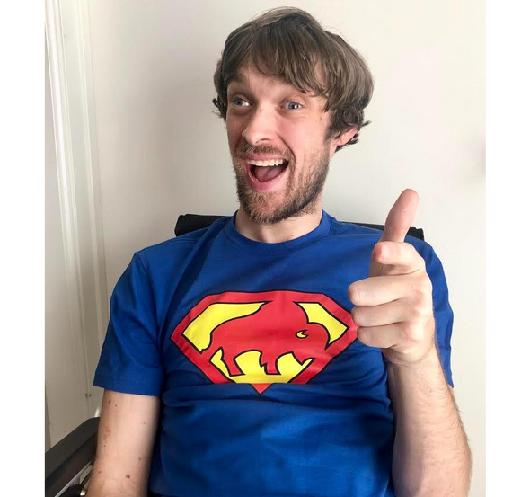 Unisex T-Shirt, Royal (modeled by comedian and writer Zach Anner)