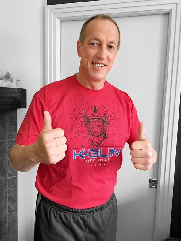 Unisex T-Shirt, Heather Red (60% cotton, 40% polyester) Modeled by Jim Kelly
