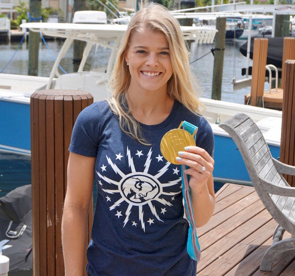 Ladies T-Shirt, Heather Navy (60% cotton, 40% polyester) Modeled by Emily Pfalzer, Olympic Gold Medalist and WNY native
