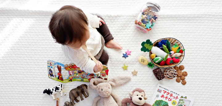 Boy surrounded by toys