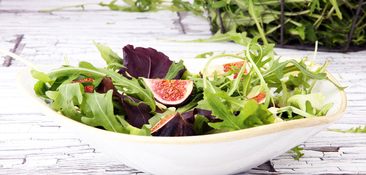 Mission figs in spring salad mix