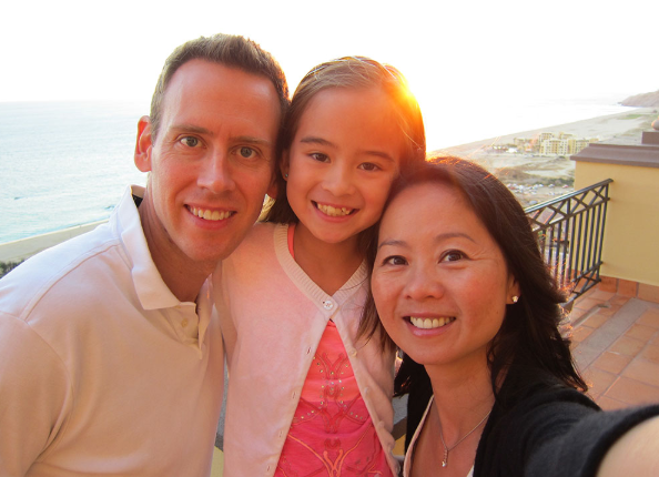 Dr. Wei, her husband Dave and her daughter Claire outside in Mexico