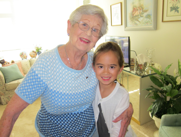 Grandma Tilly posing indoors with Dr. Wei's daughter, Claire