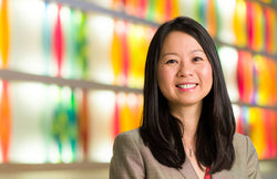 Headshot of Dr. Julie Wei against a colorful background