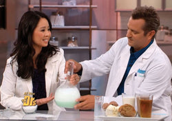 Dr. Julie Wei sitting beside a man and demonstrating acid reflux on The Doctors TV Show