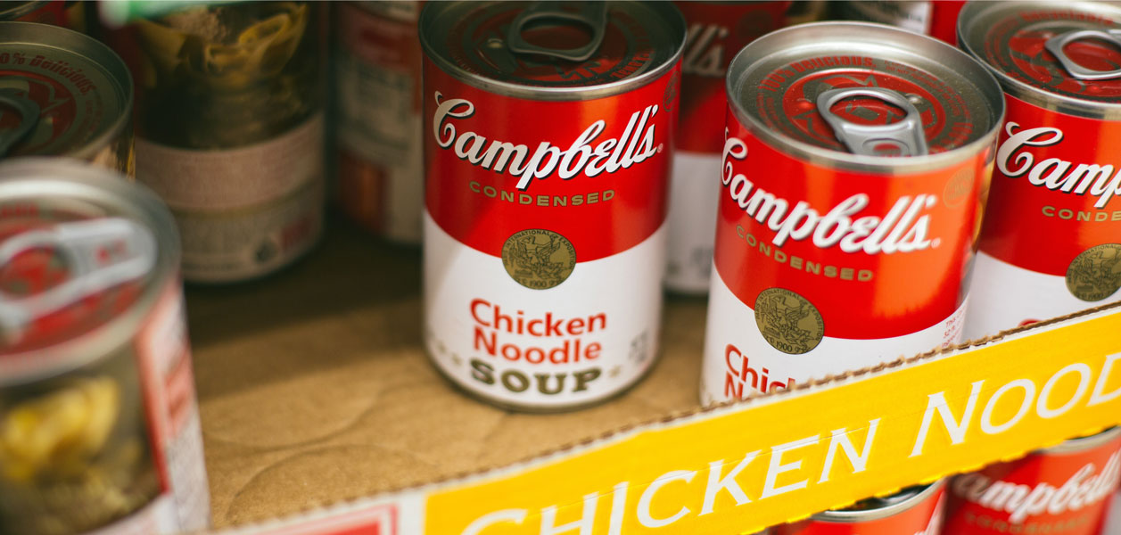 Campbell's Chicken Noodle Soup cans in a box