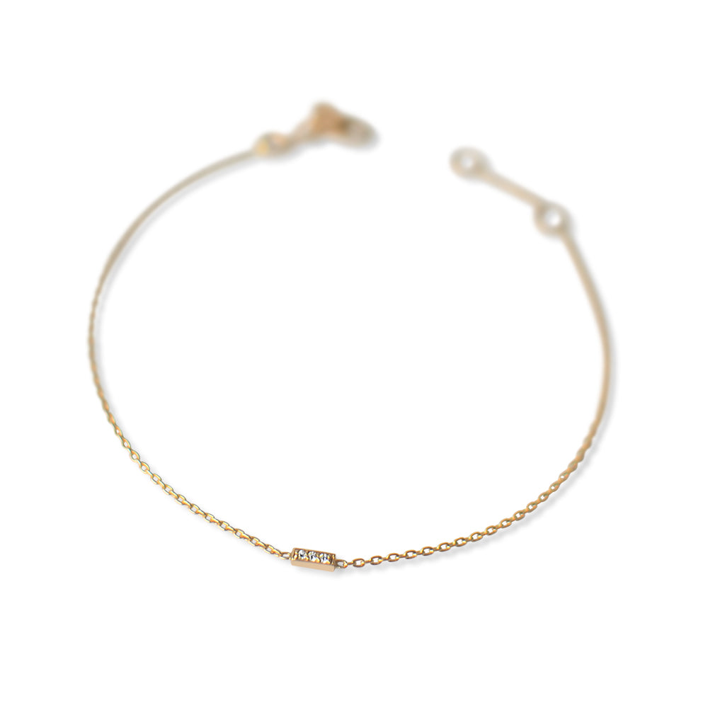 14k gold dainty bracelet with mini pave diamond bar. Fine jewellery sustainably handmade in Europe.