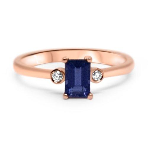 Minimal and dainty emerald-cut, deep blue purple iolite gemstone, with a small bezel set diamond on each side. Set in 14k gold, handmade sustainably and ethically in Europe.