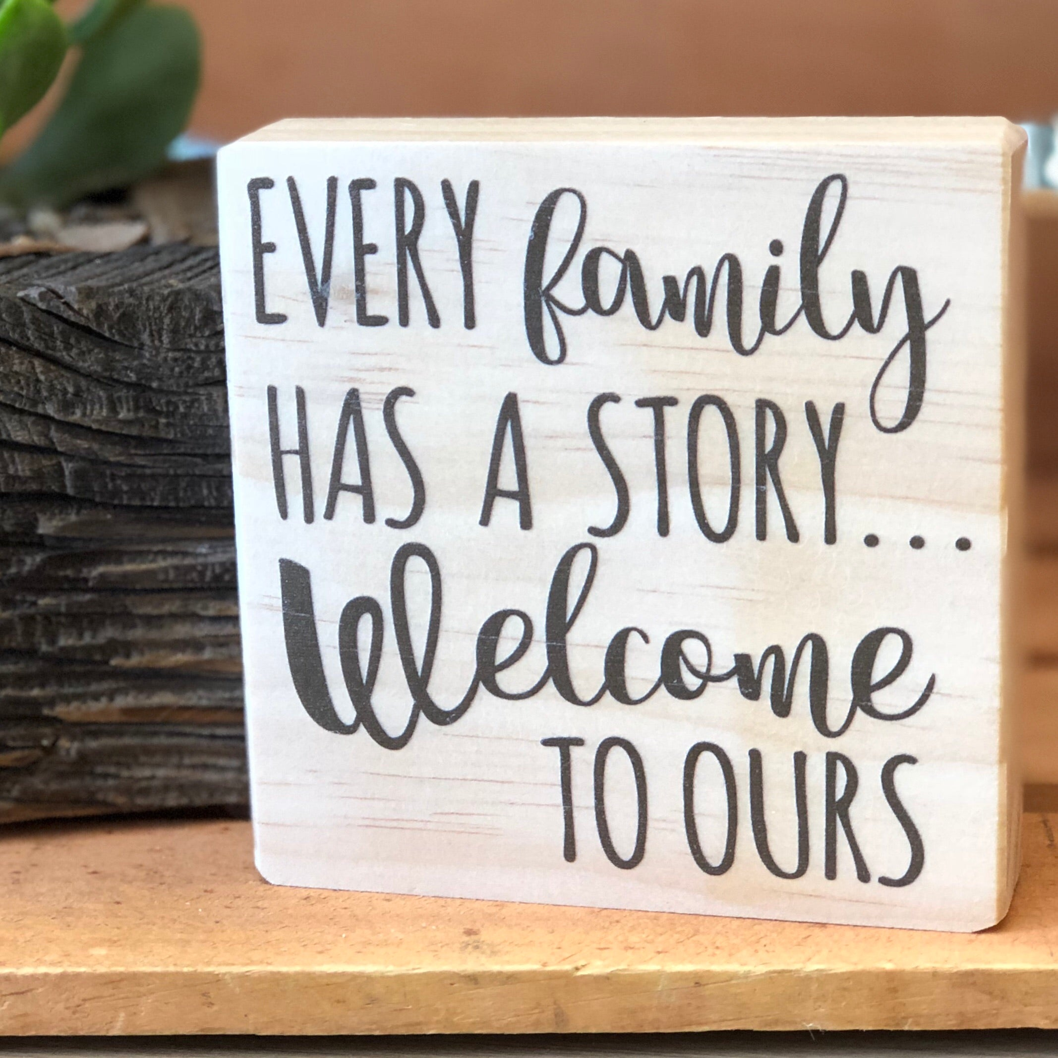 Every Family has a Story Shelf Sign