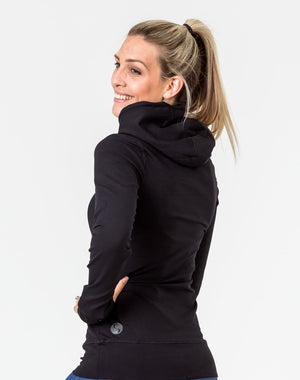 back view of a mum wearing a black activewear breastfeeding hoodie with hood up