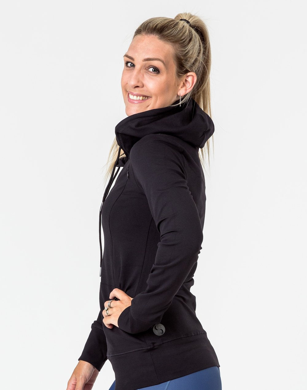 side view of a pregnant mum wearing a black activewear breastfeeding hoodie