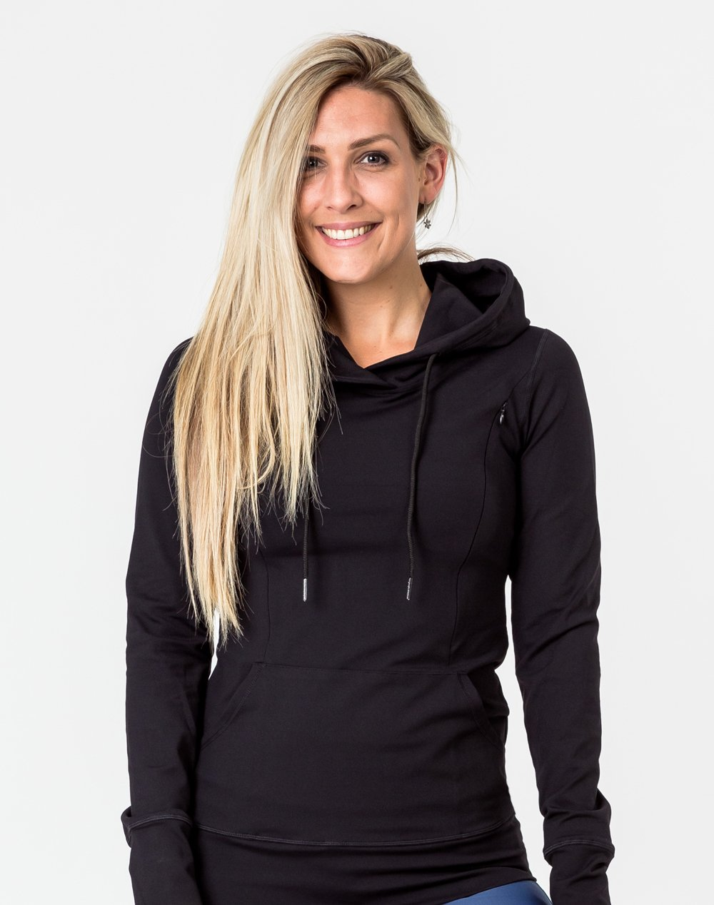 front view of an active mum wearing a black activewear breastfeeding hoodie with Cadenshae logo