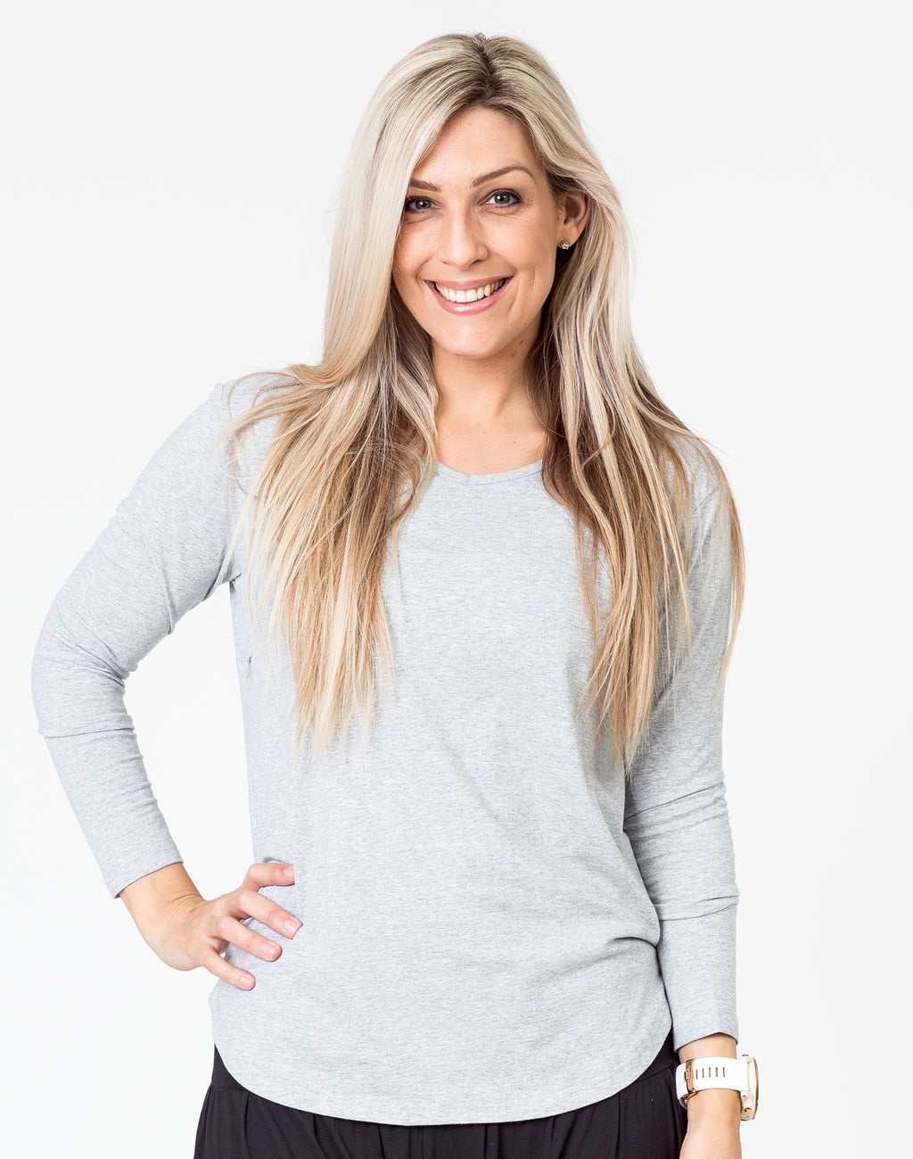active mum wearing a grey maternity top with long sleeves and invisible zips for breastfeeding