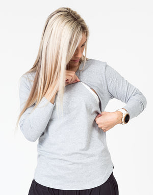 grey maternity top with long sleeves and invisible zip unzipped for breastfeeding