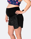 pregnant woman wearing black high waisted running shorts over the bump