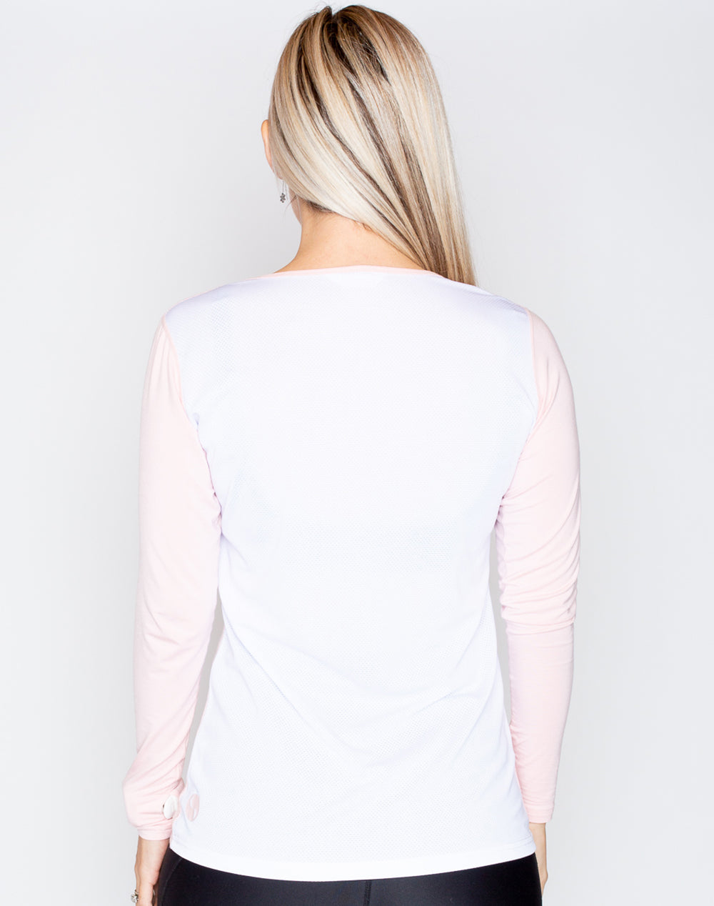 rear view of a fit mum wearing a colourful maternity top