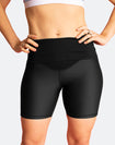 front view of woman wearing black high waisted bike shorts