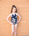 Navy floral peplum swim top