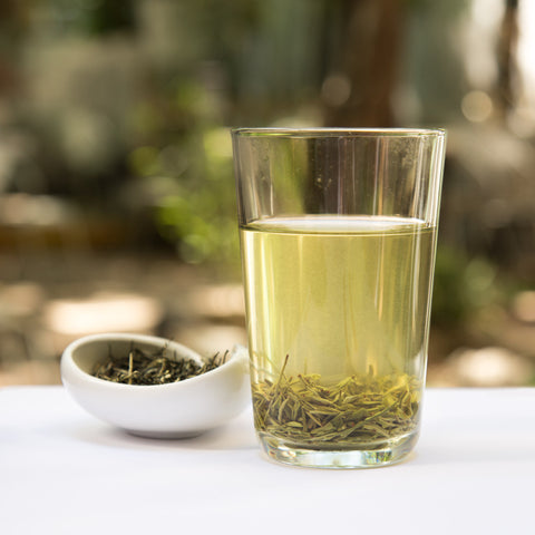 Xin Yang Mao Jian green tea steeping in glass
