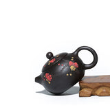Yi Xing Black Gold Sand teapot carved with Japanese apricot  flower