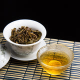 bu lang mountain raw Pu erh tea and brewed tea leaves