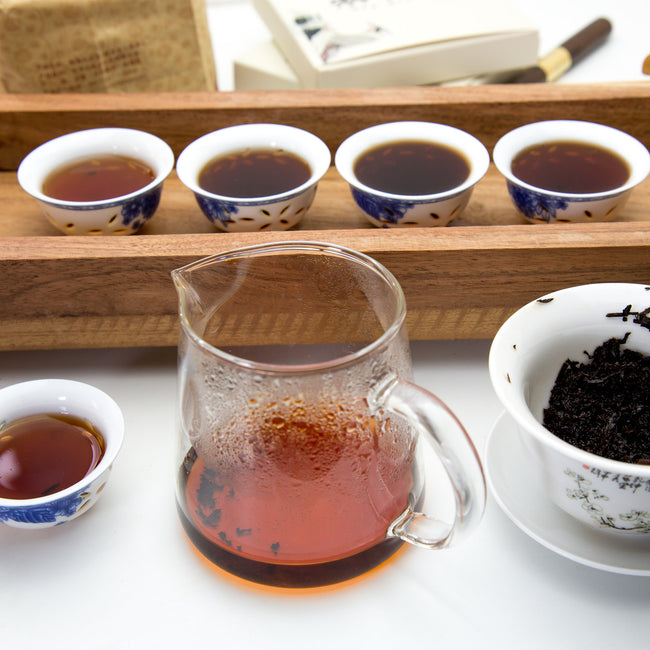 five cups of different ripe pu erh tea