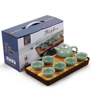 green porcelain teapot set with bamboo tea tray