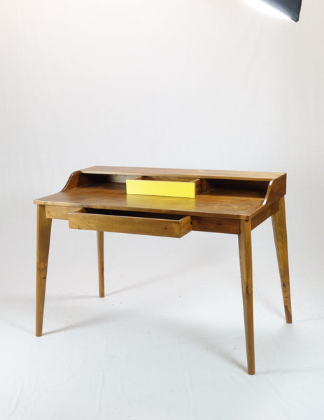 Desk with a yellow drawer