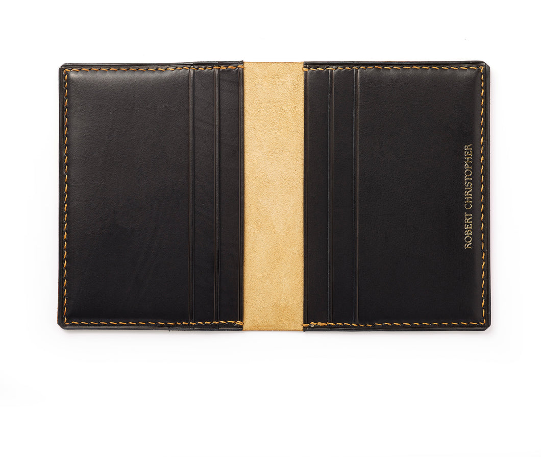 Four slot bi-fold card holder with two further compartments for notes and receipts, hand-stitched with linen thread and made using 100% vegetable tanned leather from Italy.