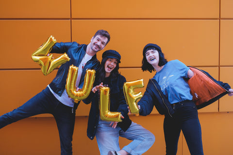 People having fun with wulf text balloons in colourful space
