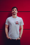 men posing in a white new day t-shirt with intense red backdrop