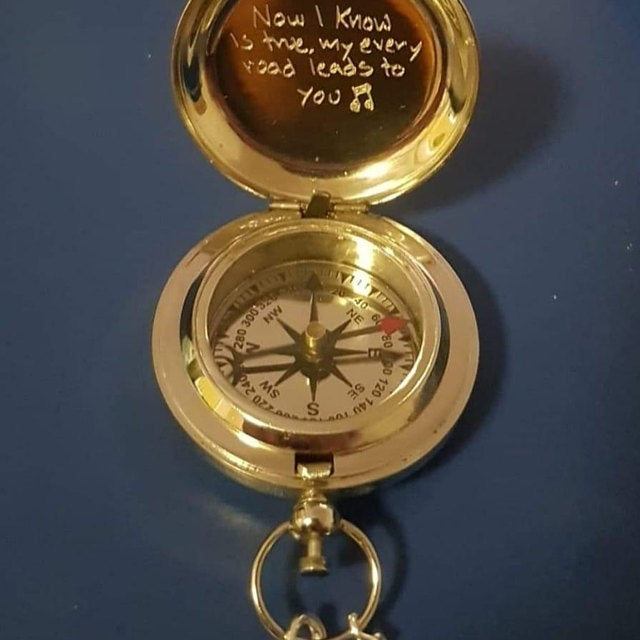 engraved brass compass
