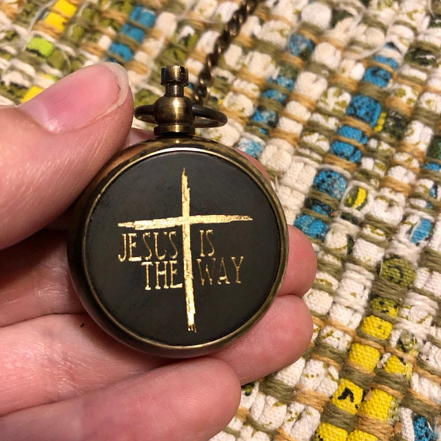 compass necklace with cross design