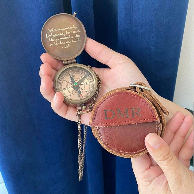 engraved compass with leather case