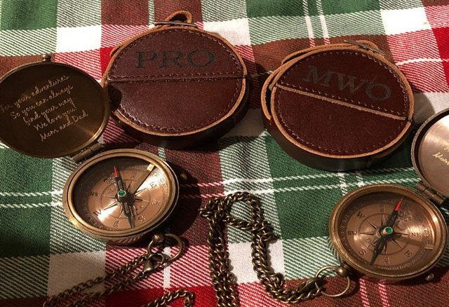 engraved compass with leather pouch