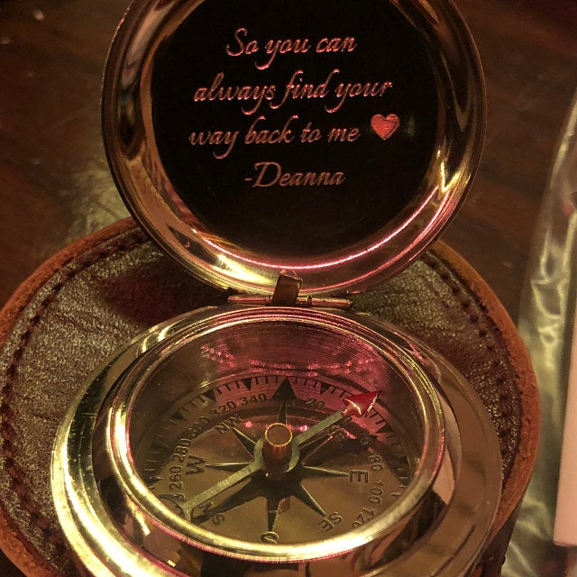 engraved compass with heart image