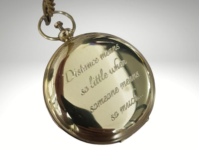 distance means so little quote engraved on compass