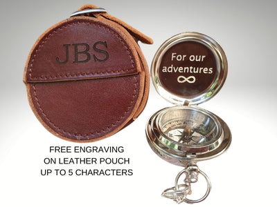 engraved silver compass with leather pouch