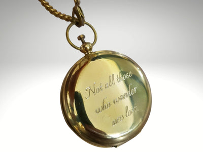 not all those who wander are lost quote engraved on working compass