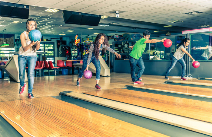 women changes up her workout with bowling