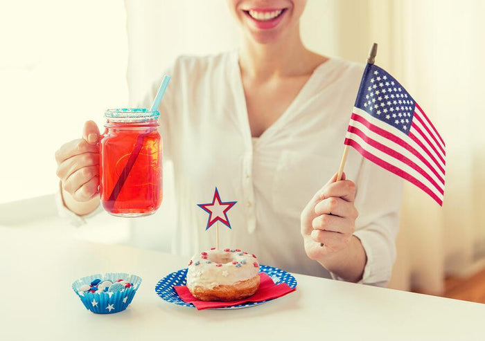 women celebrating America with a donut and drink