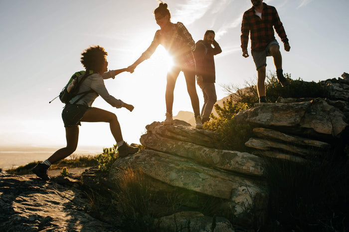 group of friends go on a fun hike during sunset