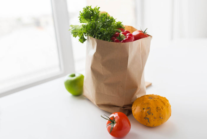 bag full of produce sitting in a window